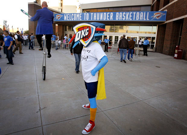 Josh Newby, of Ada, stands outside the Ford Center in his Thunder costume before the opening night NBA basketball game between the Oklahoma City Thunder and the Milwaukee Bucks on Wednesday, Oct. 29, 2008, at the Ford Center in Oklahoma City, Okla.