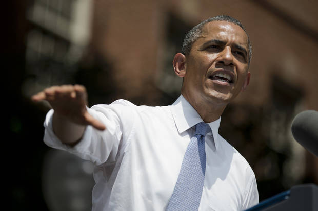 President Barack Obama gestures during a speech on climate change, Tuesday, June 25, 2013, at Georgetown University in Washington. Obama is proposing sweeping steps to limit heat-trapping pollution from coal-fired power plants and to boost renewable energy production on federal property. (AP Photo/Evan Vucci)