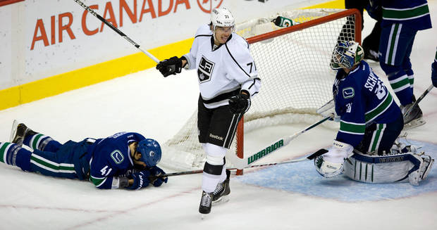 Los Angeles Kings' Jordan Nolan, center, celebrates after scoring as Vancouver Canucks' Andrew Alberts, left, lies on the ice and goalie Cory Schneider, right, watches during the second period of an NHL hockey game in Vancouver, British Columbia on Saturday, March 2, 2013. (AP Photo/The Canadian Press, Darryl Dyck)