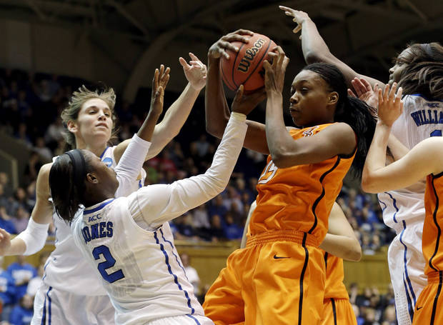 Duke's Alexis Jones (2), Allison Vernerey and Haley Peters, right, guard Oklahoma State's Toni Young during the first half of a second-round game in the women's NCAA college basketball tournament in Durham, N.C., Tuesday, March 26, 2013. (AP Photo/Gerry Broome)