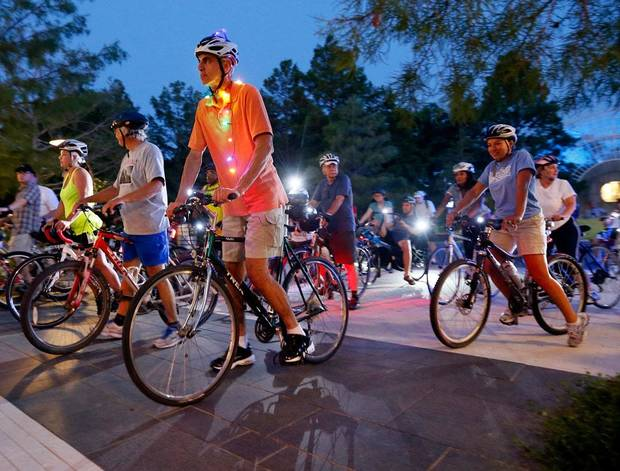 Mike O'Meara, front left, of Edmond, Okla., and other cyclists begin the Full Moon Bicycle Ride organized by the Myriad Gardens and Schlegel Bicycles in Oklahoma City, Monday, July 22, 2013. Photo by Nate Billings, The Oklahoman