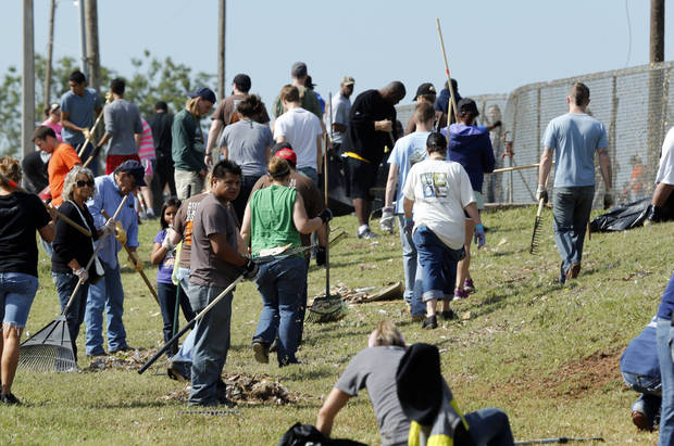Volunteers arrive at a cemetary on 4th street to clean up debris from Monday's tornado on Wednesday, May 22, 2013 in Moore, Okla. Photo by Steve Sisney, The Oklahoman