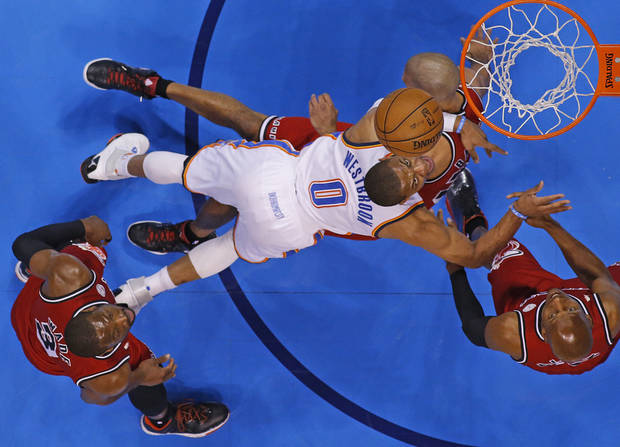 Oklahoma City's Russell Westbrook (0) runs into Miami's Shane Battier (31) as Dwyane Wade (3) and Miami's Ray Allen (34) during an NBA basketball game between the Oklahoma City Thunder and the Miami Heat at Chesapeake Energy Arena in Oklahoma City, Thursday, Feb. 15, 2013. Miami won 110-100. Photo by Bryan Terry, The Oklahoman