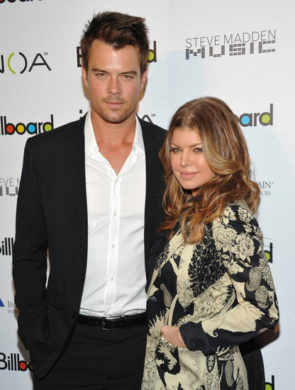 "Honoree, and singer Stacy ""Fergie"" Ferguson and husband Josh Duhamel attend Billboard's Women of the Year Award luncheon at the Pierre Hotel on Thursday, Dec. 2, 2010 in New York. (AP Photo/Evan Agostini) ORG XMIT: NYEA105"