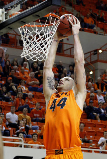 Oklahoma State's Philip Jurick (44) dunks the ball during the men's college basketball game between Oklahoma State University and Central Arkansas at Gallagher-Iba Arena in Stillwater, Okla., Sunday,Dec. 16, 2012. Photo by Sarah Phipps, The Oklahoman