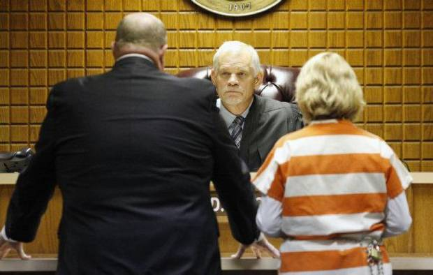 Judge Jack McCurdy, II, listens to attorney Gary James, at left, as Becky Bryan, right, wife of slain fire chief Keith Bryan, apperas for her initial arraignment at the Canadian County Courthouse in El Reno Friday, Sept. 30, 2011. Photo by Paul B. Southerland, The Oklahoman ORG XMIT: KOD