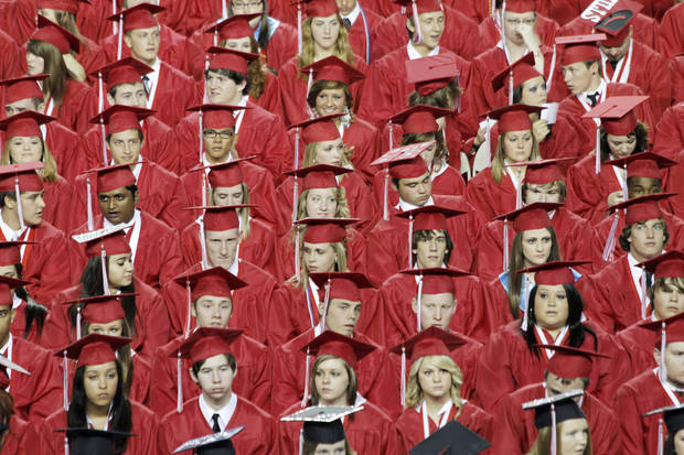 Yukon Class of 2011during the Yukon High School Class of 2011 graduation at Oklahoma State Fair Park Arena, May 26, 2011. Photo by Doug Hoke, The Oklahoman.