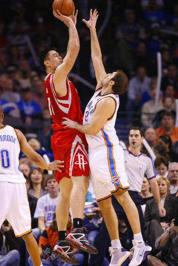 Yao Ming shoots over Nenad Krstic in the first half as the Oklahoma City Thunder plays the Houston Rockets at the Ford Center in Oklahoma City, Okla. on Friday, January 9, 2009. 