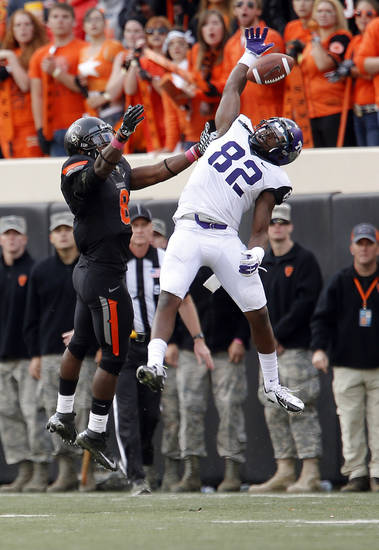 Oklahoma State's Daytawion Lowe (8) breaks up a pass intended for TCU's Josh Boyce (82) during a college football game between Oklahoma State University (OSU) and Texas Christian University (TCU) at Boone Pickens Stadium in Stillwater, Okla., Saturday, Oct. 27, 2012. Photo by Sarah Phipps, The Oklahoman