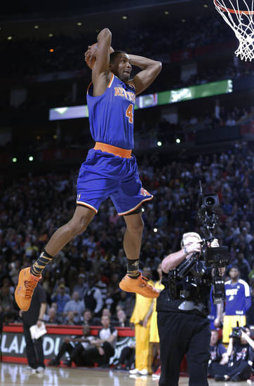 James White of the New York Knicks heads to the basket during the dunk contest at NBA basketball All-Star Saturday Night, Feb. 16, 2013, in Houston. (AP Photo/Eric Gay)