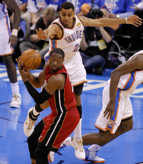 Oklahoma City's Thabo Sefolosha (2) defends Miami's Dwyane Wade (3) during Game 1 of the NBA Finals between the Oklahoma City Thunder and the Miami Heat at Chesapeake Energy Arena in Oklahoma City, Tuesday, June 12, 2012. Photo by Sarah Phipps, The Oklahoman
