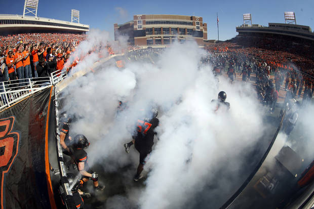 Oklahoma State runs on to the field during a college football game between Oklahoma State University (OSU) and Texas Christian University (TCU) at Boone Pickens Stadium in Stillwater, Okla., Saturday, Oct. 27, 2012. Photo by Sarah Phipps, The Oklahoman