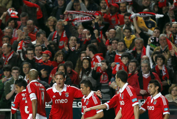 Benfica's players celebrate after Nemanja Matic, third left, from Serbia,  scored their second goal against Rio Ave during their Portuguese league soccer match at Benfica's Luz stadium in Lisbon, Saturday, March 30, 2013. Benfica defeated Rio Ave 6-1. (AP Photo/Francisco Seco)