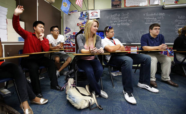 Moore High School students listen Thursday during a discussion of the presidential election in Liz Butcher�s government class.  Photo by Steve Sisney, The Oklahoman