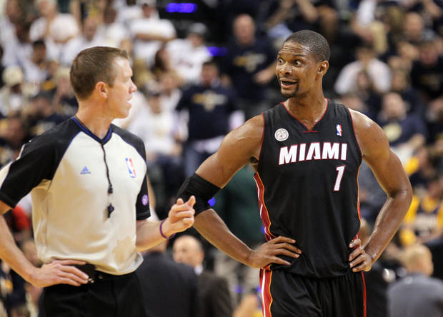 Miami Heat center Chris Bosh (1) talks with referee Ed Malloy (14) during Game 3 of an NBA Eastern Conference basketball finals against the Indiana Pacers in Indianapolis, Sunday, May 26, 2013. (AP Photo/The Miami Herald, Al Diaz)  MAGS OUT.