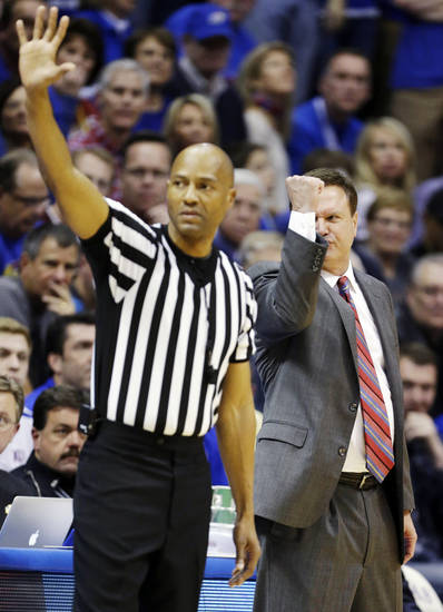 Kansas head coach Bill Self signals for a call from an official at the other end of the court while standing behind referee Bert Smith during the second half of an NCAA college basketball game against Oklahoma in Lawrence, Kan., Saturday, Jan. 26, 2013. Kansas won 67-54. (AP Photo/Orlin Wagner) ORG XMIT: KSOW110