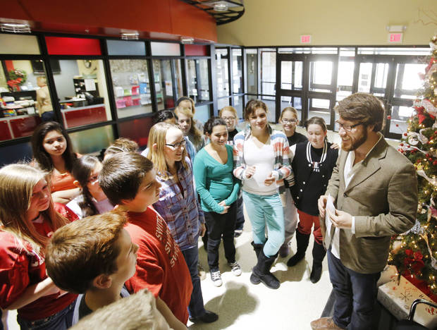 Wishing Well Executive Director Ryan Groves talks with Cimarron Middle School students after they presented him a check for $1,484. Wishing Well is a nonprofit that builds wells in developing countries. Photo By Steve Gooch, The Oklahoman <strong>Steve Gooch - The Oklahoman</strong>