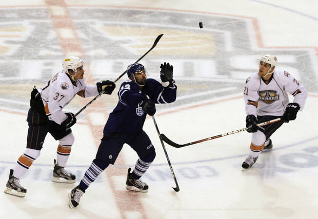 OKC's Anton Lander (37), Tanner House (21) and Toronto's Nazem Kadri (13) watch a puck fall during a game between the Oklahoma City Barons and the Toronto Marlies at the Cox Convention Center in Oklahoma City, Friday, May 18, 2012.  Photo by Garett Fisbeck, For The Oklahoman