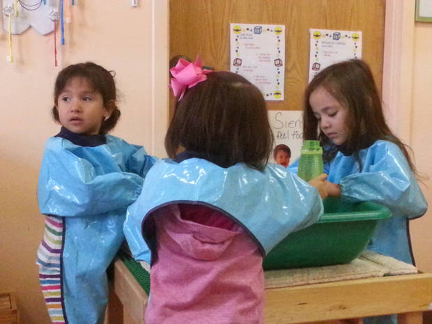 Three students in the 3- and 4-year-old class at the bilingual Head-Start program play with bubbles as a sensory exercise. Photo by Chris Brannick, The Oklahoman