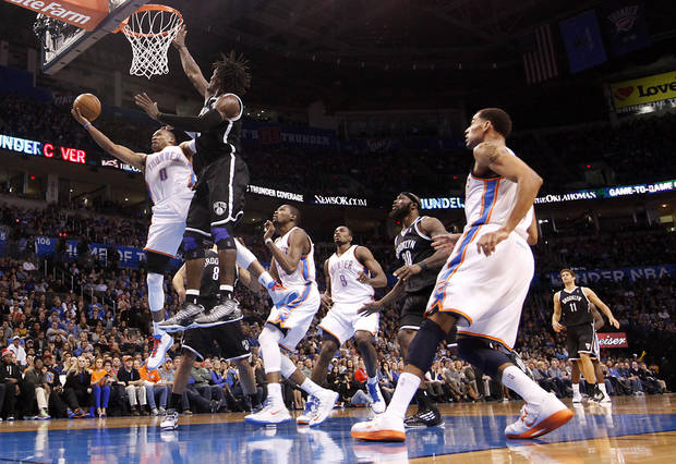 Oklahoma City&#039;s Russell Westbrook (0) drives to the basket past Brooklyn Nets&#039; Gerald Wallace (45) during the NBA basketball game between the Oklahoma City Thunder and the Brooklyn Nets at the Chesapeake Energy Arena on Wednesday, Jan. 2, 2013, in Oklahoma City, Okla. Photo by Chris Landsberger, The Oklahoman