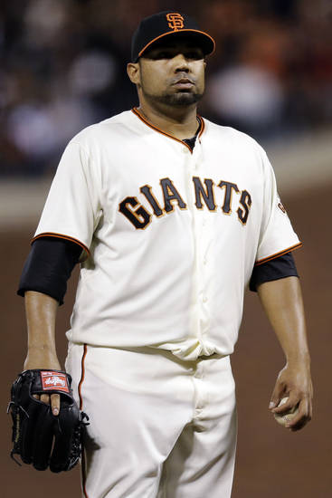 San Francisco Giants pitcher Jose Mijares reacts after giving up two runs in the eighth inning during Game 2 of the National League division baseball series against the Cincinnati Reds in San Francisco, Sunday, Oct. 7, 2012. (AP Photo/Marcio Jose Sanchez)