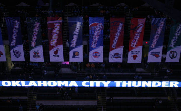 NBA banners hang from the Ford Center catwalk during the first half of the opening night NBA basketball game between the Oklahoma City Thunder and the Milwaukee Bucks on Wednesday, Oct. 29, 2008, at the Ford Center in Oklahoma City, Okla.