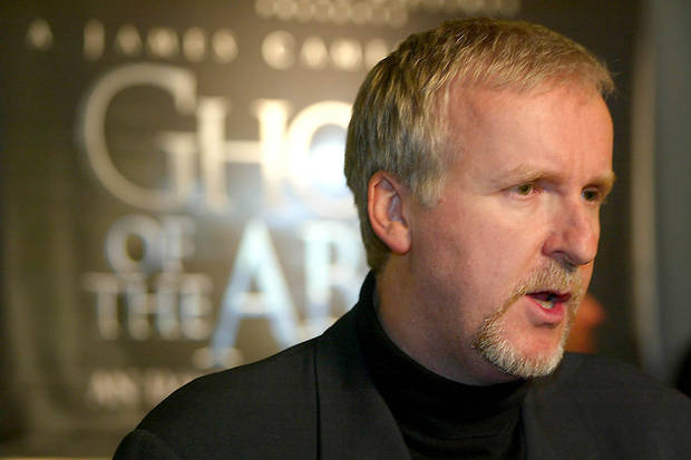"James Cameron speaks to reporters at a red carpet event in the Maryland Science Center in Baltimore, Monday evening, April 7, 2003, before the premiere of the film ""Ghosts of the Abyss,"" which he directed. (AP Photo/ Matt Houston)"