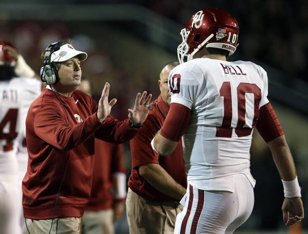 Oklahoma head coach Bob Stoops, left, talks to quarterback Blake Bell (10) after Oklahoma was topped short of the end zone on a fourth-and-goal play by Baylor in the first half of an NCAA college football game, Thursday, Nov. 7, 2013, in Waco, Texas. (AP Photo/Tony Gutierrez)
