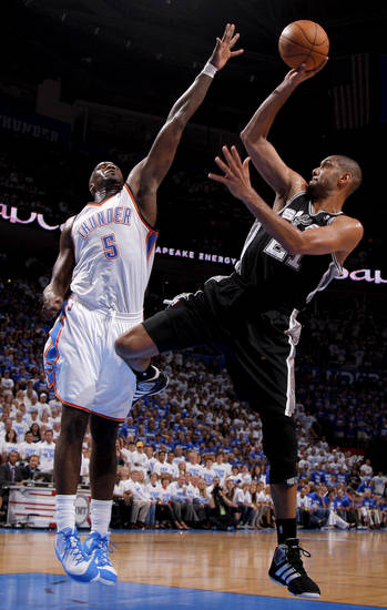 San Antonio's Tim Duncan (21) puts up a shot over Oklahoma City's Kendrick Perkins (5) during Game 4 of the Western Conference Finals between the Oklahoma City Thunder and the San Antonio Spurs in the NBA playoffs at the Chesapeake Energy Arena in Oklahoma City, Saturday, June 2, 2012. Oklahoma CIty won 109-103. Photo by Bryan Terry, The Oklahoman