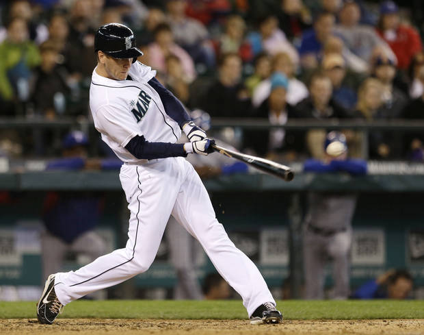 Seattle Mariners' Jason Bay singles in the winning run against the Texas Rangers in the 13th inning in a baseball game on Sunday, May 26, 2013, in Seattle. The Mariners won 4-3. (AP Photo/Elaine Thompson)