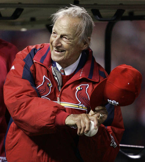 FILE - In this Oct. 27, 2006, file photo, Hall of Famer Stan Musial gets ready to throw out the ceremonial first pitch before Game 5 of the World Series between the St. Louis Cardinals and Detroit Tigers in St. Louis. Musial, one of baseball's greatest hitters and a Hall of Famer with the Cardinals for more than two decades, died Saturday, Jan 19, 2012, the team announced. He was 92.(AP Photo/Elise Amendola, File)