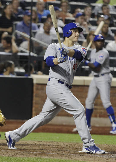 Chicago Cubs' Anthony Rizzo follows through on a three-run home run during the fifth inning of a baseball game against the New York Mets on Friday, July 6, 2012, in New York. (AP Photo/Frank Franklin II)
