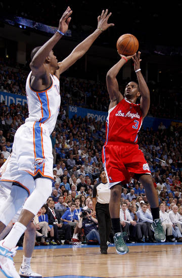 Los Angeles' Chris Paul (3) puts up a shot beside Oklahoma City's Kevin Durant (35) during the NBA basketball game between the Oklahoma City Thunder and the Los Angeles Clippers at Chesapeake Energy Arena in Oklahoma City, Wednesday, April 11, 2012. Oklahoma City lost 100-98. Photo by Bryan Terry, The Oklahoman