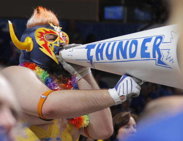 Thunder fans cheer on the team during the first round NBA playoff game between the Oklahoma City Thunder and the Denver Nuggets on Sunday, April 17, 2011, in Oklahoma City, Okla. Photo by Chris Landsberger, The Oklahoman