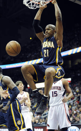 Indiana Pacers power forward David West (21) dunks against the Atlanta Hawks during the first half of an NBA basketball game on Saturday, Dec. 29, 2012, at Philips Arena  in Atlanta. (AP Photo/John Amis)