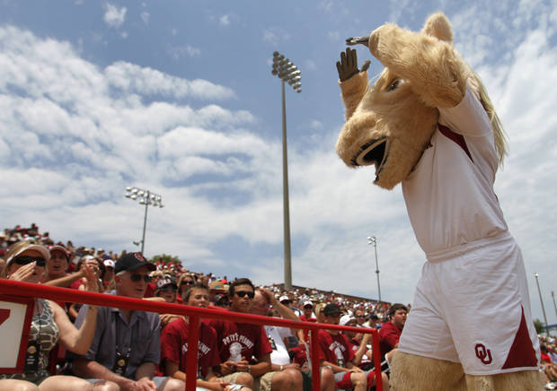 OU mascot, Sooner, entertains the crowd during a Women's College World Series game between Oklahoma University and Arizona State University at ASA Hall of Fame Stadium in Oklahoma City, Sunday, June 3, 2012.  Photo by Garett Fisbeck, The Oklahoman