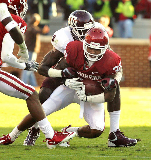 Oklahoma's Jamell Fleming (32) intercepts a  pass intended for Texas A&M's Jeff Fuller (8) during the second half of the college football game where the Texas A&M Aggies were defeated by the University of Oklahoma Sooners (OU) 41-25 at Gaylord Family-Oklahoma Memorial Stadium on Saturday, Nov. 5, 2011, in Norman, Okla. Photo by Steve Sisney, The Oklahoman