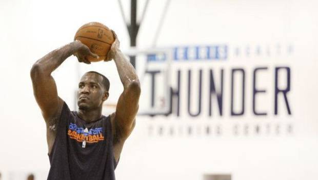 Oklahoma City Thunder's Kendrick Perkins shoots free throws during practice in Oklahoma City, March 1 , 2011. Photo by Steve Gooch, The Oklahoman <strong>Steve Gooch</strong>