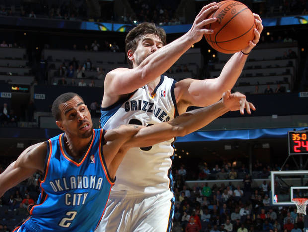 Memphis Grizzlies center Marc Gasol, of Spain, right, grabs a rebound away from Oklahoma City Thunder guard Thabo Sefolosha, of Switzerland, during the second half of an NBA basketball game Tuesday, Jan. 10, 2012, in Memphis, Tenn. The Thunder defeated the Grizzlies 100-95. Gasol led the scoring for the Grizzlies with 20 points. (AP Photo/Nikki Boertman). ORG XMIT: TNNB104