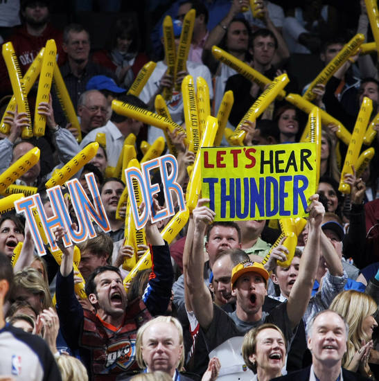 Thunder fans cheer during the NBA basketball game between the Washington Wizards and the Oklahoma City Thunder at the Oklahoma City Arena in Oklahoma City, Friday, January 28, 2011. The Thunder won, 124-117, in double overtime. Photo by Nate Billings, The Oklahoman