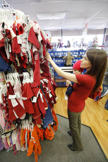 Kristen Zakariassen shops for baby clothes with her 5-month-old son, Dechlan, at Once Upon A Child in Oklahoma City. <strong>Steve Gooch - The Oklahoman</strong>