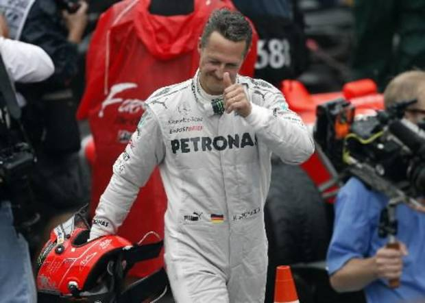 Mercedes Grand Prix driver Michael Schumacher, of Germany, flashes a thumbs up at the end of the Formula One Brazilian Grand Prix at the Interlagos race track in Sao Paulo, Sunday, Nov. 25, 2012. Seven-time world champion Schumacher is retiring after the 2012 season. (AP)