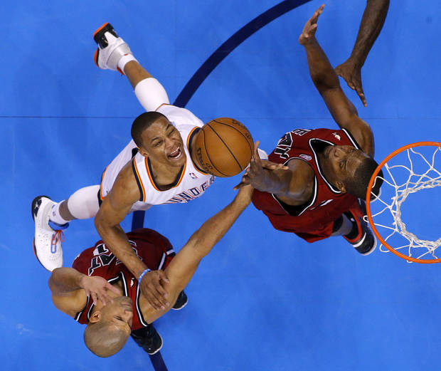 Oklahoma City's Russell Westbrook (0) tries to go to the basket between Miami's Shane Battier (31) and Miami's Chris Bosh (1) during an NBA basketball game between the Oklahoma City Thunder and the Miami Heat at Chesapeake Energy Arena in Oklahoma City, Thursday, Feb. 15, 2013. Photo by Bryan Terry, The Oklahoman