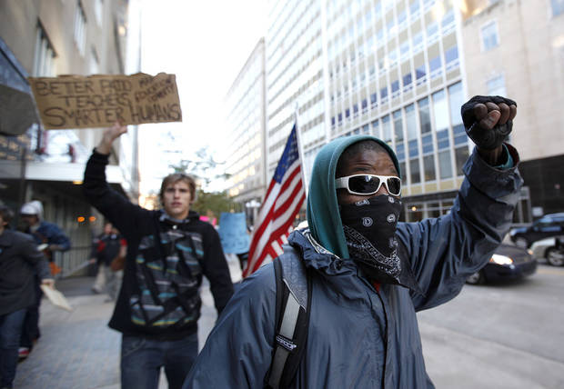Jymie Johnson marches during an Occupy Oklahoma protest in Oklahoma City,  Thursday, Nov. 17, 2011.  Photo by Sarah Phipps, The Oklahoman ORG XMIT: KOD