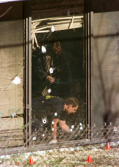 Orange cones mark evidence outside as ATF agents inspect inside areas near blast-damaged windows of an abortion clinic Monday Jan. 20, 1996, in Tulsa, Okla. Two explosions rocked the clinic Sunday, Jan. 19, 1997, for the second time this month. (AP Photo/Michael Wyke)