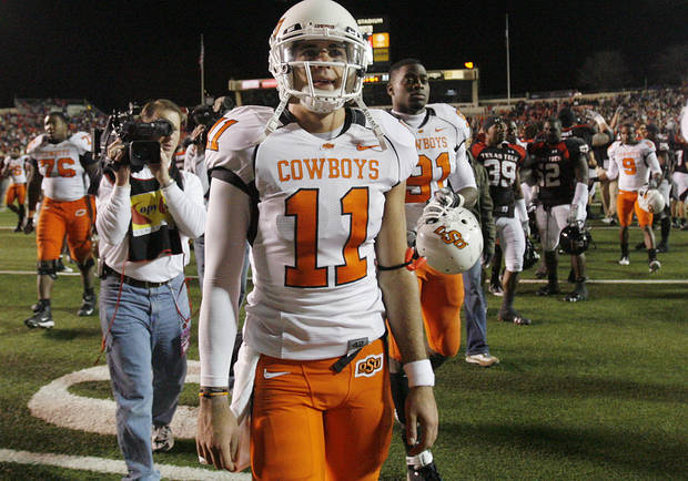 Oklahoma State's Zac Robinson walks off the field after the 56-20 loss to Texas Tech during the college football game between the Oklahoma State University Cowboys (OSU) and the Texas Tech Red Raiders at Jones AT&T Stadium on Saturday, Nov. 8, 2008, in Lubbock, Tex.