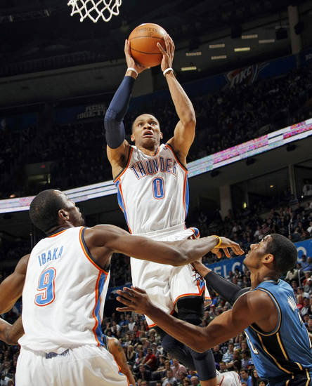 Oklahoma City's Russell Westbrook (0) takes a shot over Serge Ibaka (9) and Washington's John Wall (2) during the NBA basketball game between the Washington Wizards and the Oklahoma City Thunder at the Oklahoma City Arena in Oklahoma City, Friday, January 28, 2011. The Thunder won, 124-117, in double overtime. Photo by Nate Billings, The Oklahoman