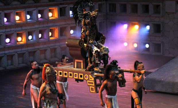 Mayan dancers perform at the Xcaret Eco Theme Park on the outskirts of Playa del Carmen, Mexico, Wednesday, Dec. 19, 2012. Amid a worldwide frenzy of advertisers and new-agers preparing for a Maya apocalypse, one group is approaching Dec. 21 with calm and equanimity, the people whose ancestors supposedly made the prediction in the first place. (AP Photo/Israel Leal)