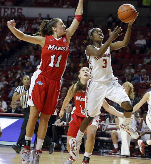 Oklahoma's Aaryn Ellenberg (3) shoots a basket as Marist's Leanne Ockenden (11) defends during the women's college basketball game between the University of Oklahoma and Marist at Lloyd Noble Center in Norman, Okla.,  Sunday,Dec. 2, 2012. Photo by Sarah Phipps, The Oklahoman