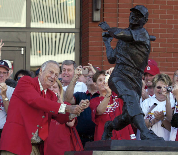 "CORRECTS YEAR TO 2013 - FILE - In this Oct. 1, 2006, file photo, St. Louis Cardinals great Stan ""The Man"" Musial strikes his signature pose after unveiling his statue at the re-dedication ceremony for the statues, at the new Busch Stadium, of Cardinals Hall-of- Famers and notables before a baseball game against the Milwaulkee Brewers in St. Louis. Musial, one of baseball's greatest hitters and a Hall of Famer with the St. Louis Cardinals for more than two decades, died Saturday, Jan 19, 2013, the Cardinals announced. He was 92. (AP Photo/Tom Gannam, File)"